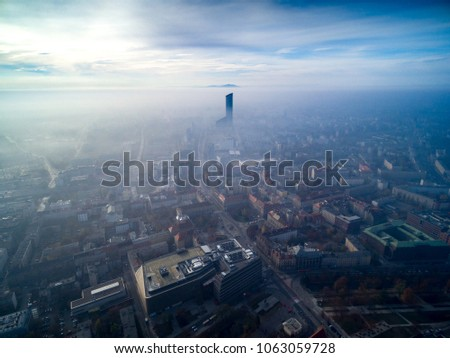 Sky Tower w chmurach widok z powietrza, Wroclaw from the sky Zdjęcia stock ©