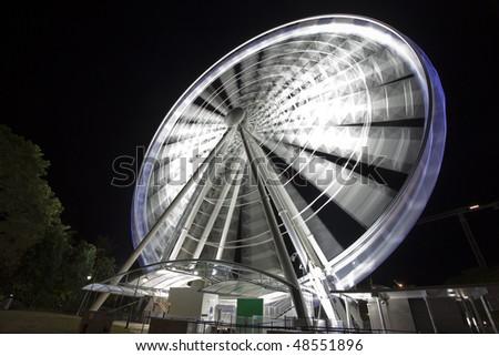 Sky wheel illuminated at night
