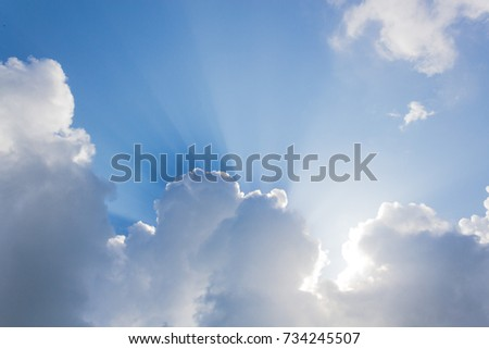 Sky with clouds and sun rays from the bottom