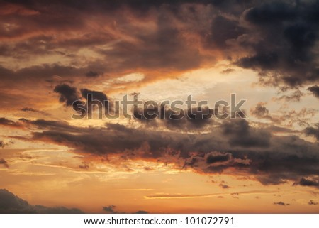 sky with clouds at sunset during storm