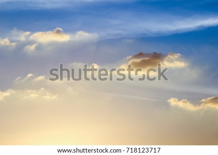 Sky with clouds in the sunset blue sun light #718123717