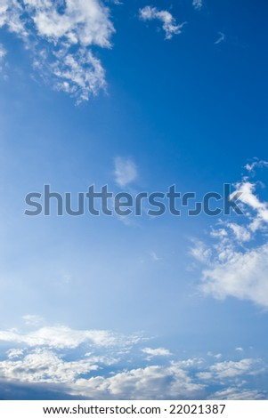 sky with drifting white clouds