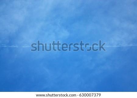 Sky with plane trail #630007379