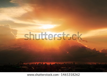 Sky with sunbeams radiating out under colorful  during a sunset.line light shining through the clouds #1465318262