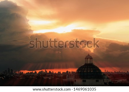 Sky with sunbeams radiating out under colorful  during a sunset.line light shining through the clouds #1469061035