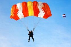 Skydiver falls through the air. Parachuting is fun!