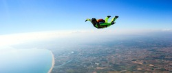 Skydiver free fall parachute man. Skydiving free fall man. Space games background sunset