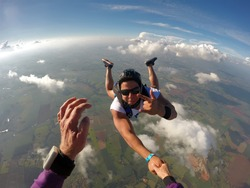 Skydiver hand shake point of view