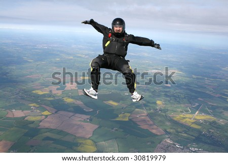 Skydiver in a sit position facing the cameraman