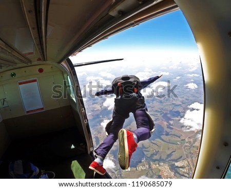 Skydiver jump out of plane #1190685079