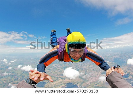 Skydiver senior man, smiling in free fall