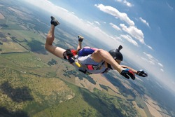 Skydiver without jumpsuit freefalling during hot summer