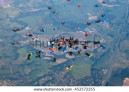 skydivers building a formation #452572255