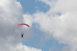 Skydivers free falling and parachuting
