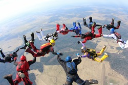 Skydivers in the sky.