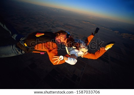 Skydiving couple kissing on mid-air