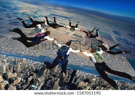 Skydiving executives forming a circle in mid-air