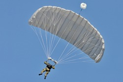 Skydiving -extreme sports- parachutist with a parachute unfolded.