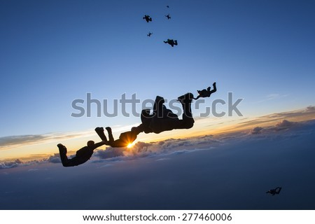 Skydiving formation at sunset Stock photo ©
