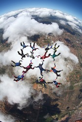 skydiving formation over the clouds