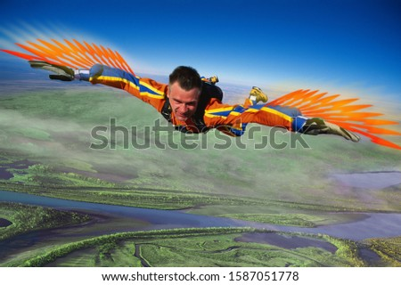 Skydiving man in bird costume shown in mid-air