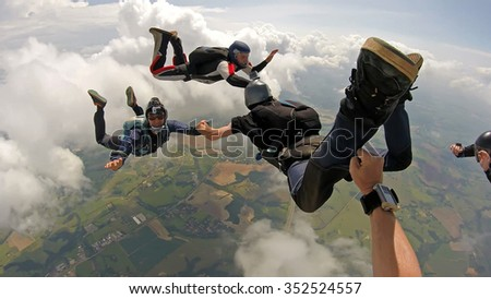 Skydiving point of view. Young and middle aged friends, having fun. Soft focus.