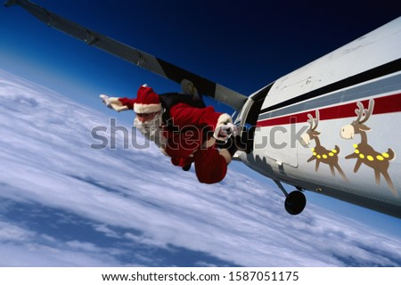 Skydiving Santa Claus jumping from a small airplane