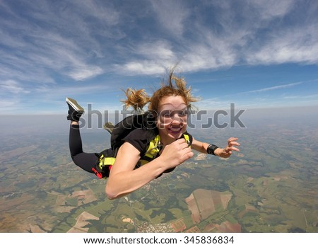 Skydiving smiling beautiful woman
