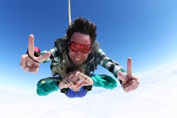 Skydiving tandem heart sign