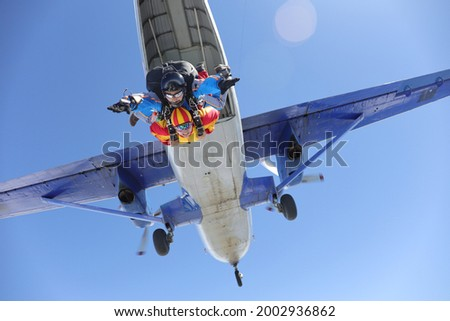 Skydiving. Tandem jump. An amazing adventure into the sky. Stock photo ©