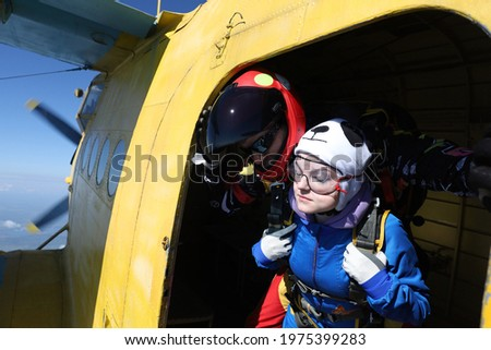 Skydiving. Tandem jump. First step into the sky. Stock photo ©