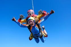 Skydiving. Tandem jump. Passenger is having fun.
