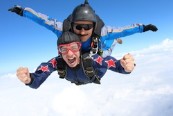 Skydiving. Tandem passenger is very happy.