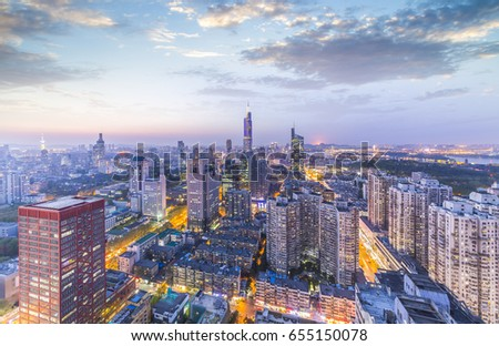 skyline and cityscape of modern city at night.nanjing,china #655150078