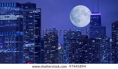 Skyline and Large Moon on the Horizon. Downtown Chicago with Hancock Tower on the Right Side. Panoramic Chicago Skyline.