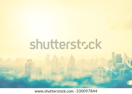 Skyline city concept: Abstract blurred urban sunset background #330097844