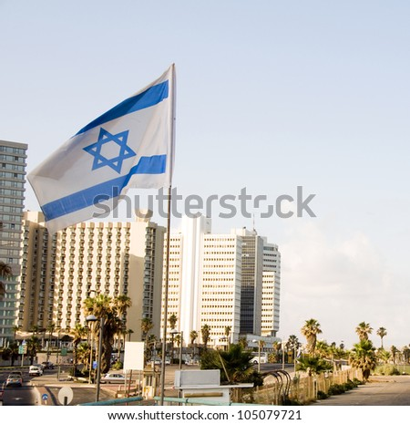 skyline cityscape with national Israeli flag and high rise hotel buildingsTel Aviv Israel
