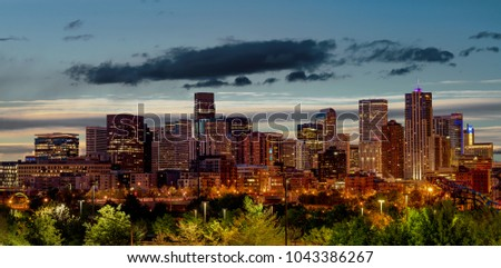 Skyline close up of Denver Colorado with the lights of morning