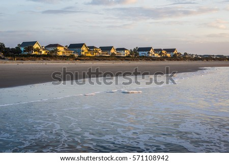 Skyline of Beach Homes at Ise of Palms Beach, in Charleston South Carolina at Sunrise #571108942