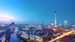 Skyline Of Berlin in Germany with TV Tower, Berlin Town Hall and a busy street in the evening