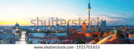 Skyline Of Berlin in Germany with TV Tower, Berlin Town Hall and a busy street in the evening ストックフォト ©