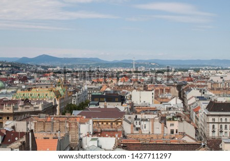 Skyline of Budapest, Hungary. Rooftop view from the tower of St. Stephen's Basilica. Buildings, towers and colorful rooftops. European capital city skyline. #1427711297