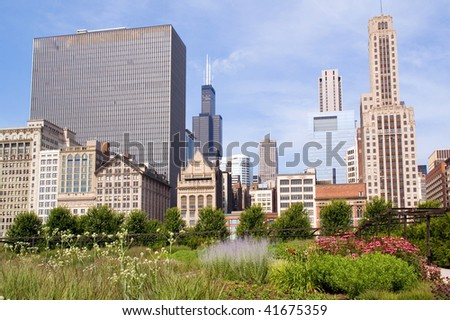 Skyline of Downtown Chicago and a colorful garden by the Millennium Plaza
