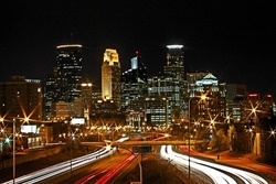 Skyline of downtown Minneapolis, Minnesota taken from the 35W Bridge overpass at night in Long Exposure HDR.