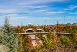 Skyline of Downtown Tulsa from the top on the south tunnel over Riverside Drive close to the Arkansas River in Autumn