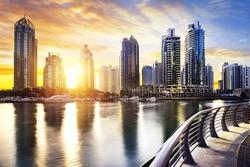 skyline of Dubai Marina at night with boats, United Arab Emirates, Middle East