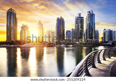 skyline of Dubai Marina at night with boats, United Arab Emirates, Middle East