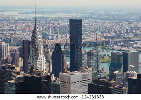 Skyline of Manhattan in New York City, United States, with the Empire State Building and Brooklyn Bridge