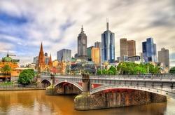 Skyline of Melbourne along the Yarra River and Princes Bridge in Australia