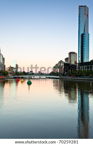 Skyline of Melbourne and the Yara River at dawn